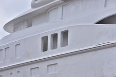 Unpainted and unfinished luxury yacht under construction Stock Photos