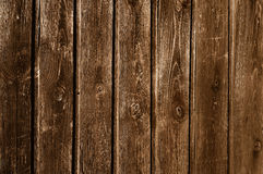 Darkened unpainted wooden fence Stock Image