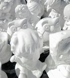 Unpainted white plaster cartoon doll royalty free stock photos