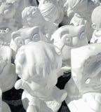 Unpainted white plaster cartoon doll Royalty Free Stock Photos