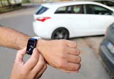 Unparking a autonomous car with a smartwatch Royalty Free Stock Photos