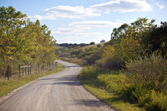Unpaved Country Road And Pasture Royalty Free Stock Photography