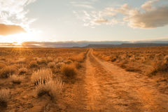 Unpaved desert road Royalty Free Stock Photo