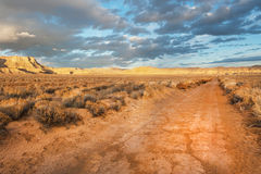 Unpaved desert road Stock Photography