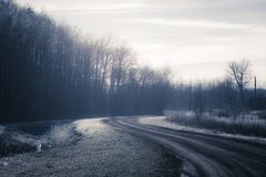 Unpaved road in frozen landscape Royalty Free Stock Photography