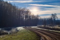 Unpaved road in frozen landscape Royalty Free Stock Images
