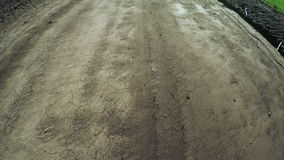 Unpaved road. Section between dirt road and field stock video footage