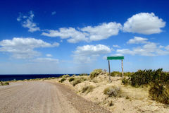 Unpaved road to the ocean Stock Images