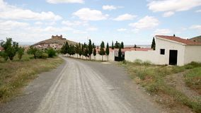 A rural path going to La Calahorra town. An unpaved rural path going to La Calahorra town, Province of Granada, Spain stock footage