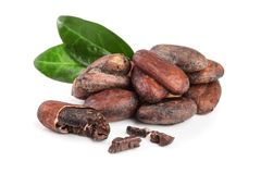 Unpeeled cocoa bean with leaf isolated on white background Royalty Free Stock Photography