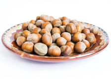 Unpeeled hazelnuts plate Royalty Free Stock Photo