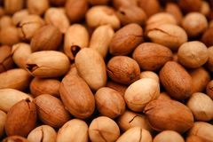 Unpeeled pecans lie on the counter close-up. stock images