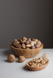 Unpeeled and peeled nuts Royalty Free Stock Images