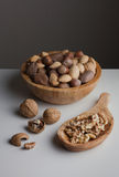 Unpeeled and peeled nuts Royalty Free Stock Photography
