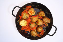 Unpeeled Potatoes in a Pan Royalty Free Stock Photo
