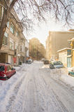 Unpeeled snowy streets of Pomorie, Bulgaria, winter Royalty Free Stock Photo
