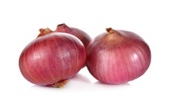 Unpeeled whole red onion, shallots on white Stock Photography