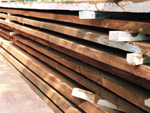 Unplaned thick planks covered with antiseptic preparation Royalty Free Stock Photo