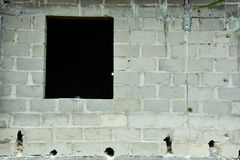 Unplastered cement wall. Picture of an un-plastered cement wall with a space for window on a side. its a wall of a building currently still under construction Stock Images