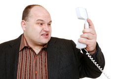Unpleasant call. Man in suit has a unpleasant call Royalty Free Stock Image