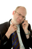 Unpleasant call. Man with hand on his tie during an unpleasant call stock photos