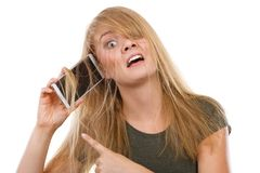 Crazy young woman talking on phone. Unpleasant conversation, bad relationships concept. Crazy young blonde weirdo woman with messy hair talking on phone. Studio Stock Photo