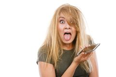 Crazy young woman talking on phone. Unpleasant conversation, bad relationships, concept. What did I say? Crazy young blonde weirdo woman with messy hair talking Stock Image
