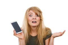 Crazy young woman talking on phone. Unpleasant conversation, bad relationships, not knowing technology concept. Crazy young blonde weirdo woman with messy hair Royalty Free Stock Photography