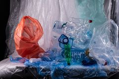 Unpleasant installation with used water bottles and bags and litters. Colors and textures. Unpleasant installation with used water bottles and bags and litters royalty free stock image