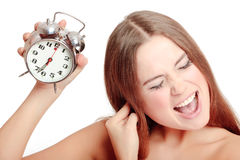 Unpleasant morning. Unhappy girl waking up too late royalty free stock images