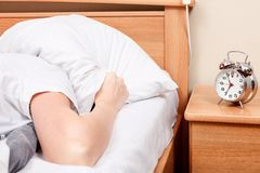 Unpleasant morning, woman in bed. Unpleasant morning. Don`t want to wake up Royalty Free Stock Image