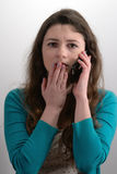 Unpleasant news. Girl heard the bad news by phone Stock Image
