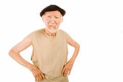 Unpleasant Senior man. On white background wearing beret royalty free stock photography