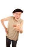 Unpleasant Senior Man. In Black Beret Pointing at Camera royalty free stock photo