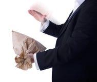 Unpleasant surprise. Concept for unpleasant surprise as a businessman pops a bag isolated on white Stock Photography