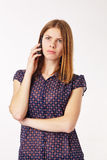 Unpleasant Talk. Young woman talking on the phone, sad and dissapointed Royalty Free Stock Image
