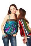 Unpleasant woman kiss. Beautiful women trying to make unpleasant kiss Stock Photography