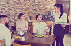 Unpleased client talking with manager in restaurant. Unpleased angry  ordinary client talking with manager in restaurant Royalty Free Stock Images