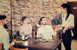 Unpleased client talking with manager in restaurant Stock Photo