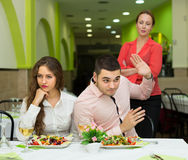 Unpleased couple in restaurant Stock Photos