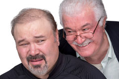 Unpleasently Disturb. Older men got in to personal space of a younger man. Younger men showing his emotions with unpleasent face Stock Photography