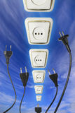 Unplug. Plugs reaching outlet in the sky royalty free stock photo