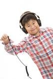 Unplug boy. A smiling boy unplug his headphone on isolated background stock photos