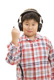 Unplug boy. A smiling boy unplug his headphone on isolated background Royalty Free Stock Images