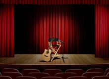 Unplug concert on stage. Unplug guitar concert on stage with spot light royalty free stock image