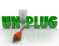 Unplug Cord Electrical Outlet Electricity Power. The word Unplug in green letters with an orange electrical cord disconnected from the power outlet Stock Photography
