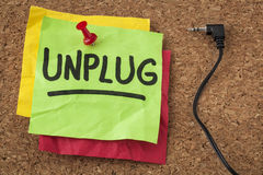 Unplug - information overload concept. Unplug - lifestyle or information overload concept - handwriting on colorful sticky notes royalty free stock photo