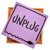Unplug - information overload concept. Unplug  - lifestyle or information overload concept  - handwriting on an isolated sticky note Royalty Free Stock Photo