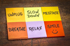 Unplug, slow down, meditate, breathe, relax, smile concept. Unplug, slow down, meditate, breathe, relax, and smile motivational lifestyle reminders on colorful Stock Photography