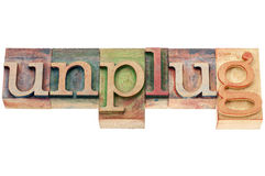 Unplug word in wood type. Unplug - lifestyle or information overload concept - text in letterpress woodtype stock image